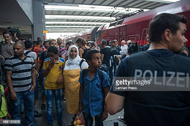 Police detain migrants who had arrived at Munich Hauptbahnhof main railway station and who had no passports or valid visas on September 1 2015 in...