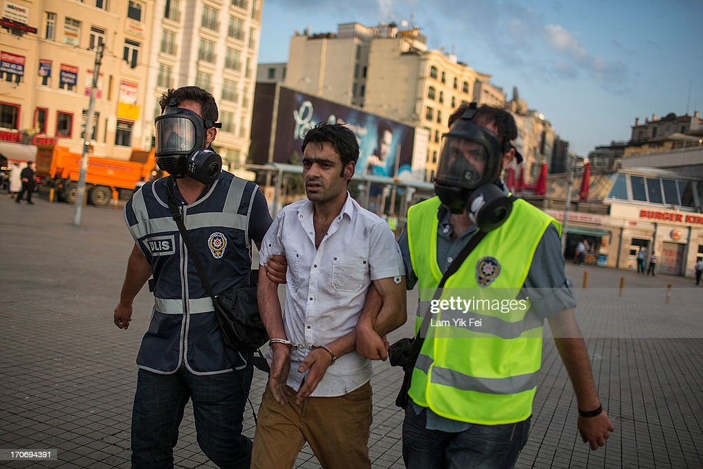 Police detain protestors after a crackdown of demonstration at Taksim Gezi Park on June 16, 2013 in Istanbul, Turkey. Istanbul has seen protests rage on for days, with two protesters and one police officer killed. What began as a protest over the fate of Taksim Gezi Park turned into a wider demonstration over Prime Minister Recep Tayyip Erdogan's policies.