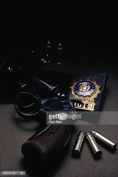 Police detective badge, revolver and bullets, (Close-up)