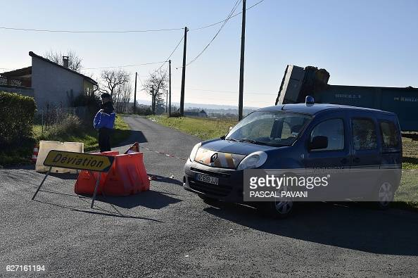 Police deviate a road leading to a duck farm in the municipality of Almayrac Tarn southwestern France on December 2 where the 'highly pathogenic'...
