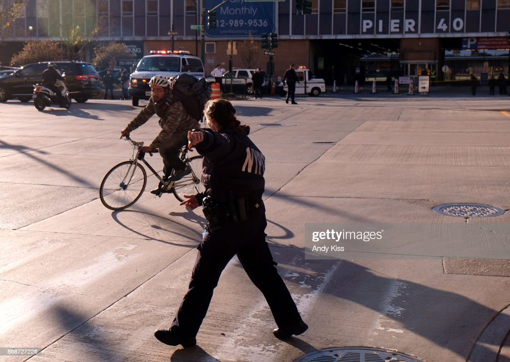 Police direct people away from the scene after reports of multiple people injured after a truck plowed through a bike path in lower Manhattan on October 31, 2017 in New York City.