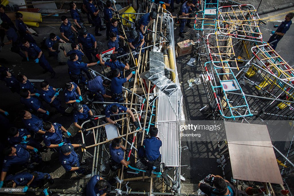 Police dismantle barricades on Queensway in the Admiralty business district of Hong Kong China on Tuesday Oct 14 2014 Hong Kong police used chain...