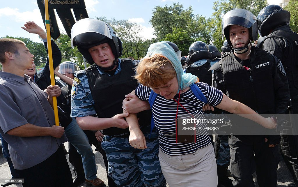 Police displace an Orthodox believer protesting against a Gay Parade in Kiev on May 25, 2013. Around a hundred gay rights activists marched in Ukraine on Saturday despite fears of violence and a court ban, marking the first gay pride event in the ex-Soviet country, where homophobia is widespread and generally accepted.