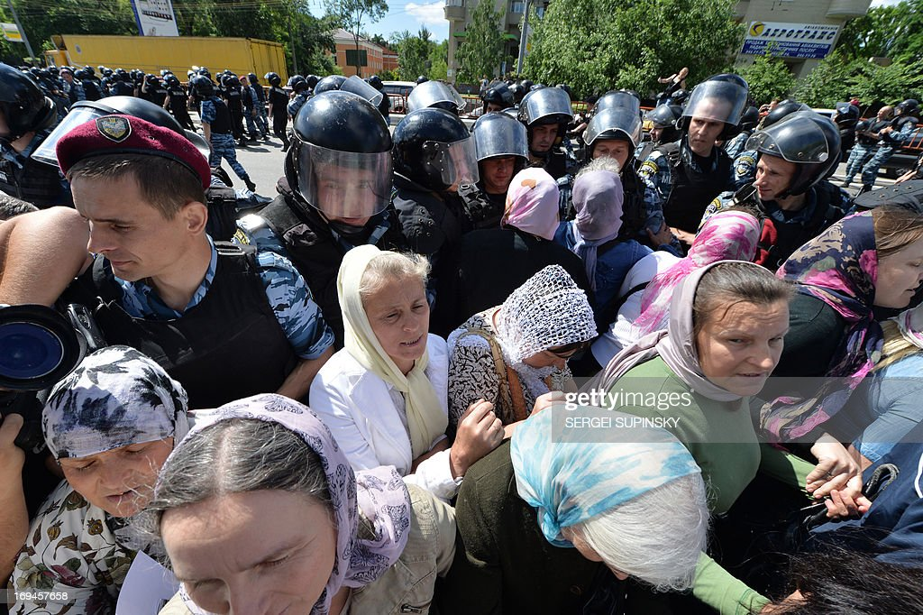 Police displace hundreds of Orthodox believers protesting against a Gay Parade in Kiev on May 25, 2013. Around a hundred gay rights activists marched in Ukraine on Saturday despite fears of violence and a court ban, marking the first gay pride event in the ex-Soviet country, where homophobia is widespread and generally accepted.