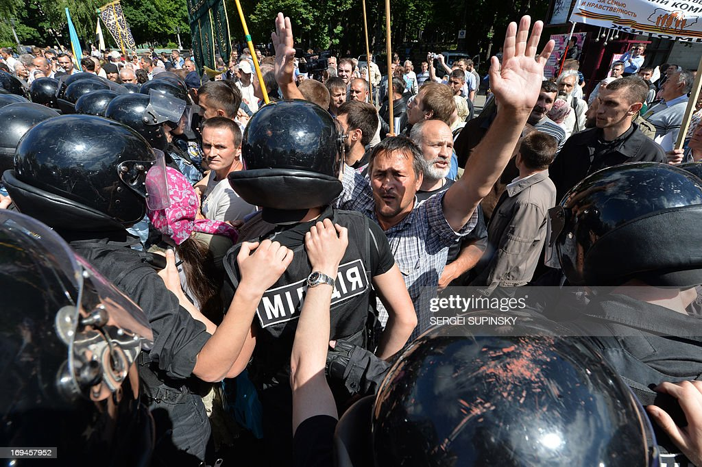 Police displace some of the hundreds of Orthodox believers protesting against a Gay Parade in Kiev on May 25, 2013. Around a hundred gay rights activists marched in Ukraine on Saturday despite fears of violence and a court ban, marking the first gay pride event in the ex-Soviet country, where homophobia is widespread and generally accepted.