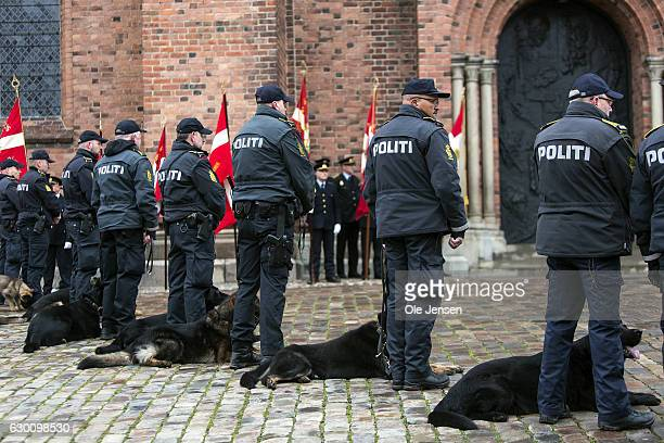 Police dog handlers line up at Roskilde Cathedral where the murdered Danish police officer Jesper Jul receives a state funeral on December 16 2016 in...