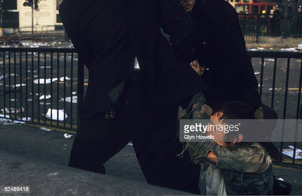 Police drag a protestor away during the Poll Tax riot in Trafalgar Square London 31st March 1990