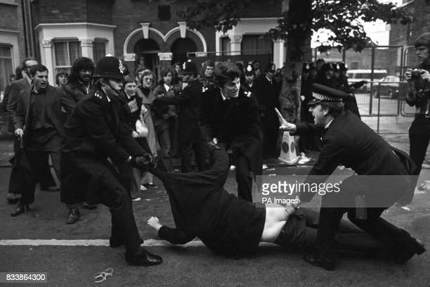 Police drag away picket during skirmishes as the week long strike at the Grunwick factory gets underway