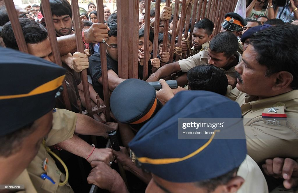 Police dragging the residents of Campa Cola Compound who locked their gates and barricaded themselves to block the entry of BMC officials who reached at the spot to begin demolition process on November 12, 2013 in Mumbai, India. Seven high-rises were constructed at what is called the Campa Cola Compound, between 1981 and 1989. The builders had permission for only five floors, but constructed several more. One of the buildings, Midtown, has 20 floors. Another building, Orchid, has 17. The Supreme Court asked the BMC to investigate, and the civic body served demolition notices for all flats constructed above the fifth floor, which it said were illegal.
