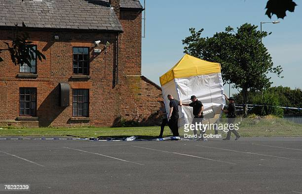 Police erect a tent to conceal the area where elevenyearold Rhys Jones was shot by a youth on a BMX bicycle on August 23 2007 in Liverpool England...