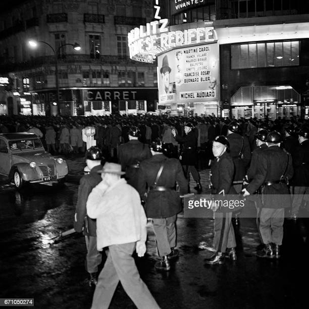 Police escort a demonstration of between 20000 and 30000 proFront de Liberation Nationale Algerians on October 17 1961 in Paris Later French police...