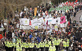 Police escort demonstrators as they take part in the 'Put People First' march through central London on March 28 2009 Tens of thousands of trade...