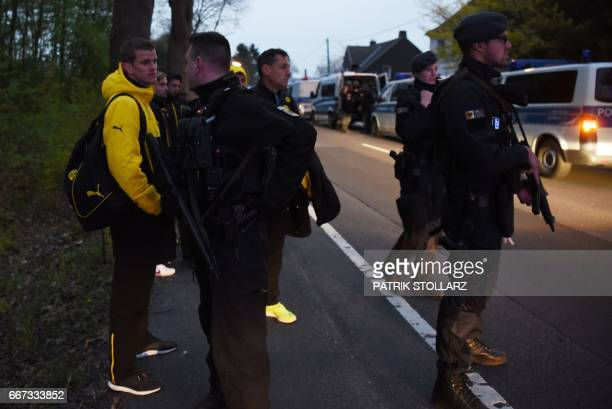 TOPSHOT Police escort Dortmund's players including Dortmund's defender Sven Bender after the team bus of Borussia Dortmund had some windows broken by...