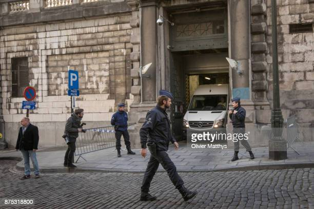 Police escort former ministerpresident of Catalonia Carles Puigdemont out of the courthouse after he appeared in front of a judge in Brussels on...