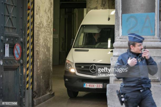 Police escort former ministerpresident of Catalonia Carles Puigdemont out of the courthouse after he appeared in front of a judge on November 17 2017...
