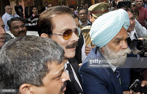 Police escort India's Sahara group chairman Subrata Roy on his arrival at the Supreme Court in New Delhi on March 4 2014 Black ink was thrown on...