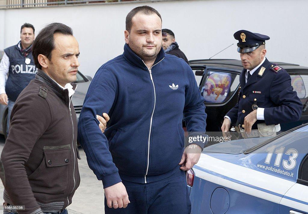Police escort the boss of Girati mafia clan in Frattamaggiore, Rosario Guarino, nicknamed 'Joe Banana' during his arrest on November 15 2012 in Naples. AFP PHOTO / CARLO HERMANN