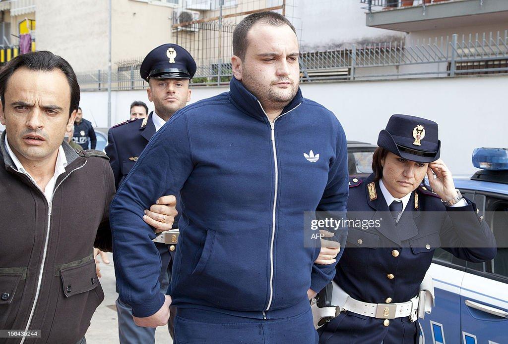 Police escort the boss of Girati mafia clan in Frattamaggiore, Rosario Guarino (C), nicknamed 'Joe Banana' during his arrest on November 15 2012 in Naples.