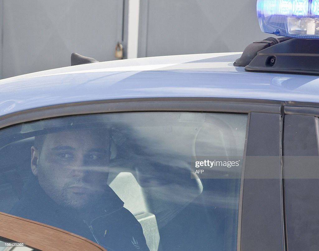 Police escort the boss of Girati mafia clan in Frattamaggiore, Rosario Guarino (C), nicknamed 'Joe Banana' during his arrest on November 15 2012 in Naples.