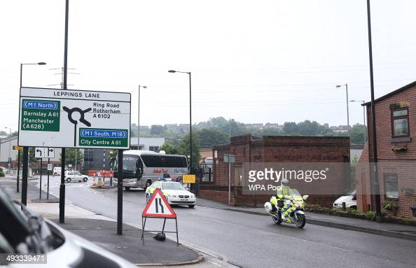 Police escort the coaches carrying the jury lawyers inquest staff and media as they arrive in Leppings Lane Sheffield for a visit to Hillsbrough...