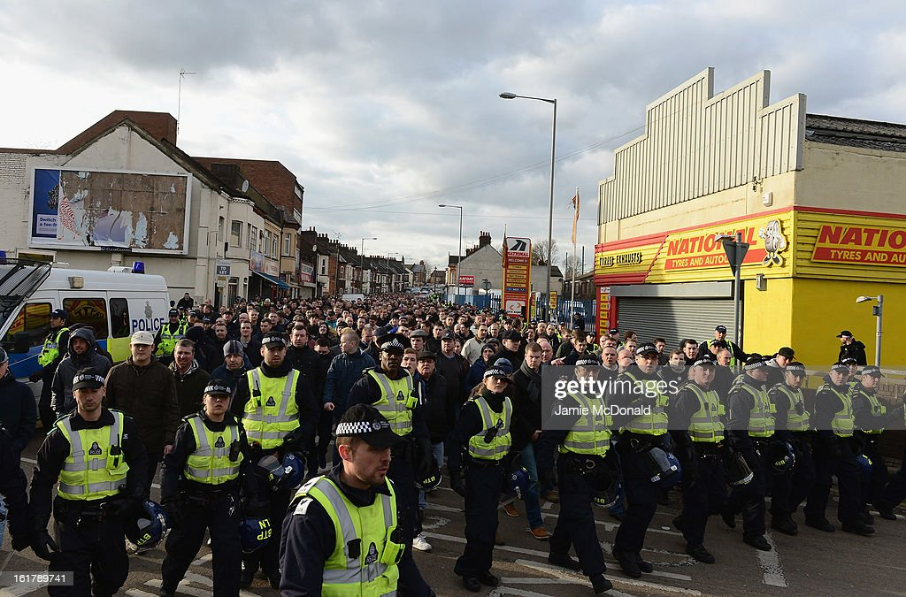 Police escort the Millwall fans to the station during the FA Cup with Budweiser firth round match between Luton Town and Millwall at Kenilworth Road on February 16, 2013 in Luton, England.