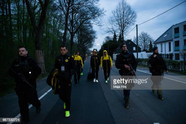 Police escort the players near after the team bus of the Borussia Dortmund football club was damaged in an explosion on April 11 2017 in Dortmund...