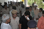 Police escort two men accused of gang raping a woman on their visit to a court in Rohtak on July 20 2016 Indian police have arrested three suspects...