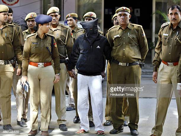 Police escort Uber cab driver Shiv Kumar Yadav who is accused of raping a woman following his court appearance at the Tis Hazari court on December 8...