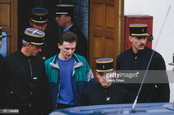 Police escorting JeanMarie Villemin during a reconstruction of the murder of his four yearold son Grégory at Lepanges Sur Vologne Vosges France 18th...