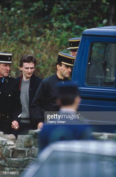 Police escorting JeanMarie Villemin during a reconstruction of the murder of his four yearold son Grégory at Docelles Vosges France 18th November...