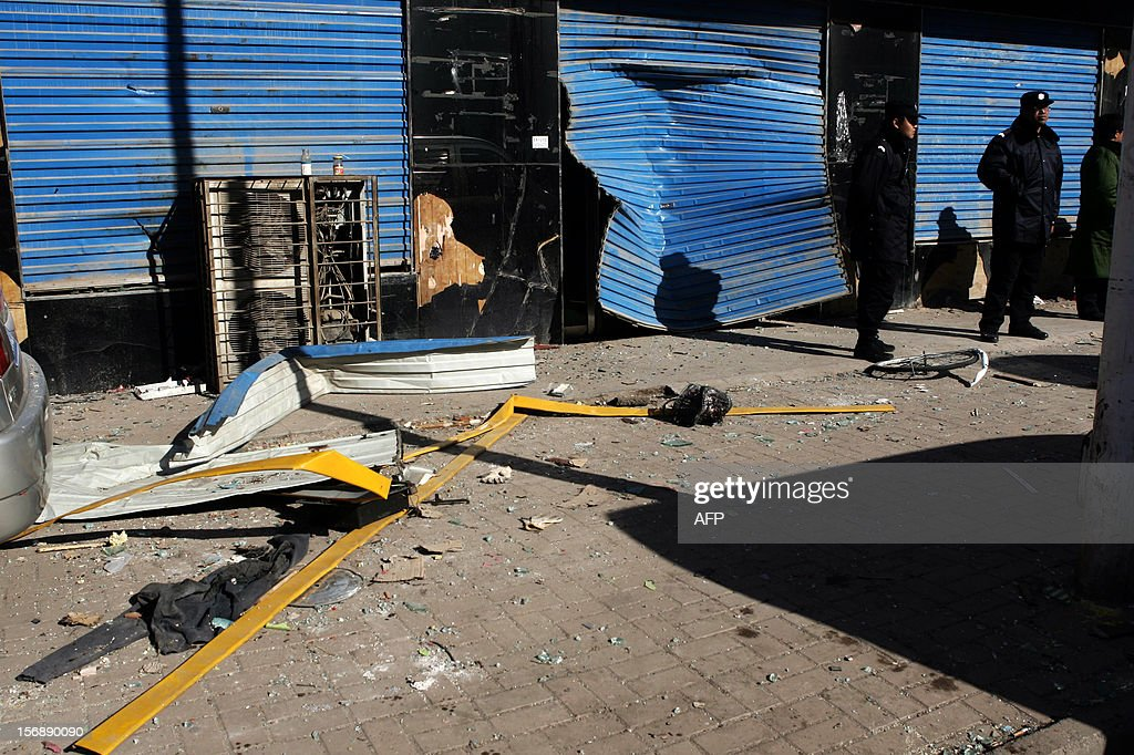 Police evacuated the hotpot restaurant and neighborhood after the explosion in Shouyang County, north China's Shanxi Province on November 24, 2012. The accident ripped through the restaurant killing 14 people and injuring another 47, state media reported. CHINA
