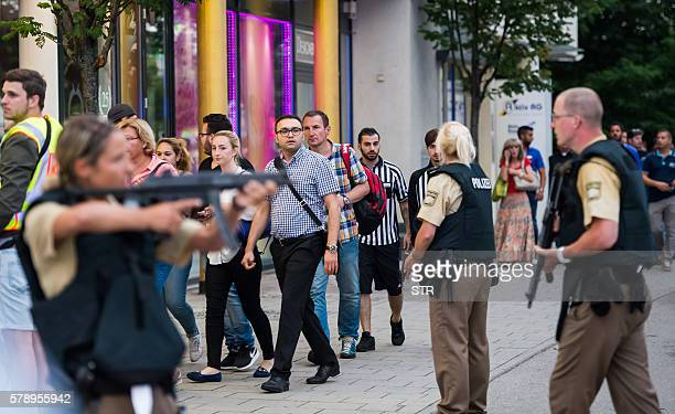 Police evacuates people from the shopping mall the Olympia Einkaufzentrum in Munich on July 22 2016 following a shootings earlier At least one person...