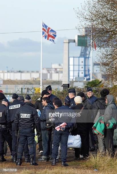 Police evacute 12 December 2007 some forty illegal immigrants mostly Iraqis from a private site they have squatted for over a month located in front...
