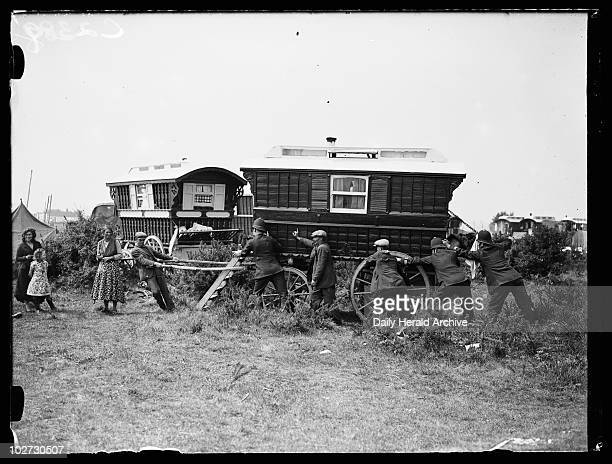 Police evicting gypsies Epsom Downs Surrey 28 May 1935 A photograph of officers moving Romanies on from a site on Epsom Downs taken by Edward...