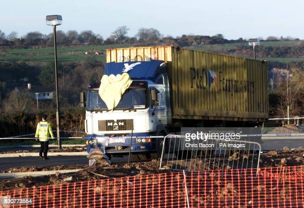 Police examine the lorry in which eight wouldbe refugees died and five others were left seriously ill after a plot to smuggle them into the Republic...