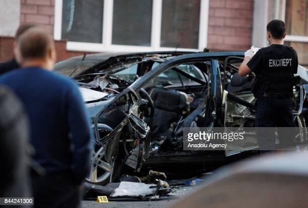 Police experts examines crime scene after a car blast killing at least one on Pavlo Skoropadsky Street near the Besarabsky Market in center Kiev...