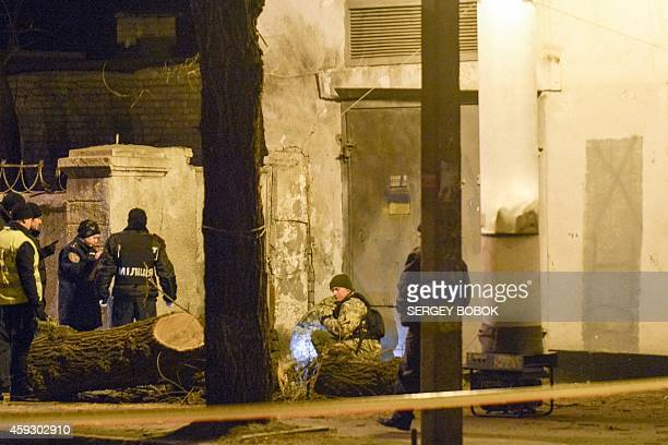 Police experts search an electrical substation near the Kharkiv military hospital on November 20 2014 after a blast No casualties were reported AFP...