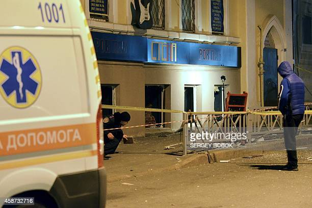 Police experts search for evidence after an explosion in a pub in the center of northeastern Ukrainian city of Kharkiv on November 10 2014 Eleven...