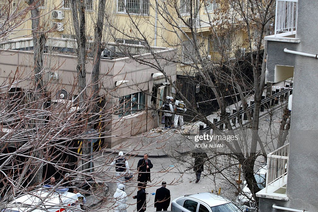 Police experts work on February 1, 2013 at the site of a blast outside the US Embassy in Ankara. Two security guards were killed in the blast outside the US embassy, local television reported, amid speculation it was a suicide attack. The force of the explosion damaged nearby buildings in the Cankaya neighborhood where many other state institutions and embassies are also located.