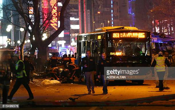 Police explore the scene after a suicide car bomb ripped through a busy square in central Ankara on March 13 killing at least 34 people and wounding...