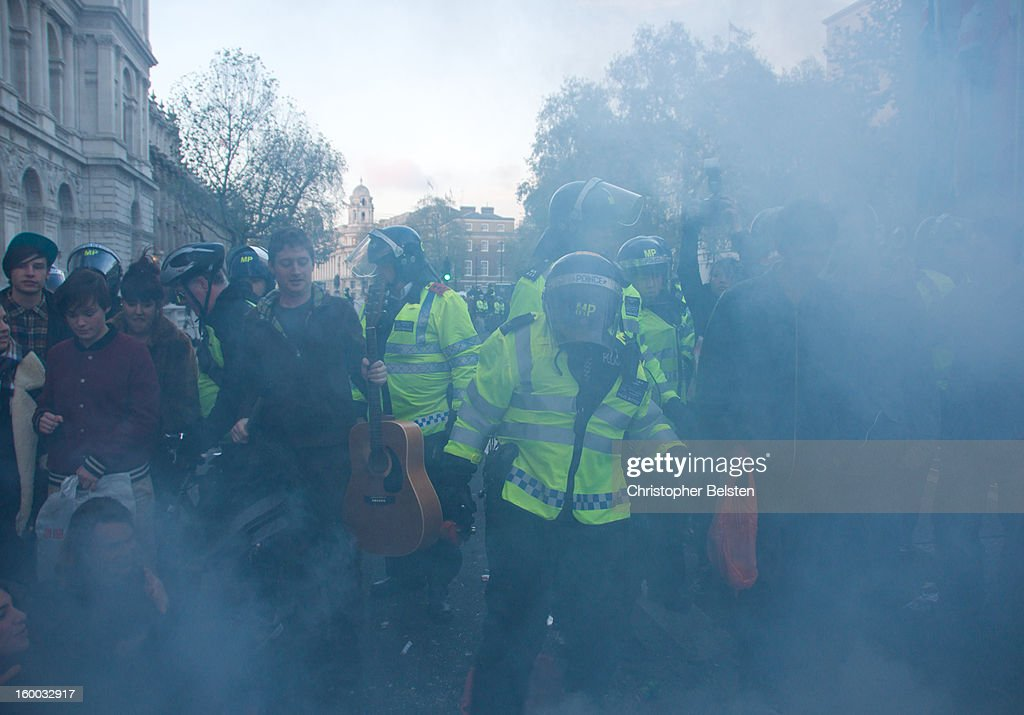 CONTENT] Police extinguish fire and break up student protest on Whitehall, London,m during the G20 Demonstrations, November 2010