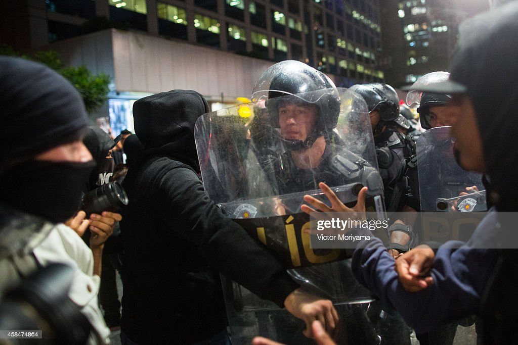 Police face off with demonstrators during a protest against the lack of water that is affecting the entire state of Sao Paulo and against...