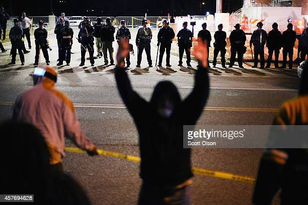 Police face off with demonstrators outside the police station as protests continue in the wake of 18yearold Michael Brown's death on October 22 2014...