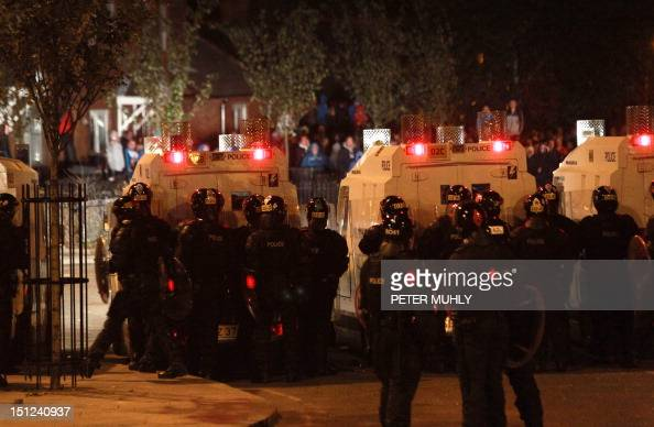 Police faces protestors during a third night of sectarian rioting in the Carlisle Circus area in Belfast Northern Ireland on September 4 2012 The...