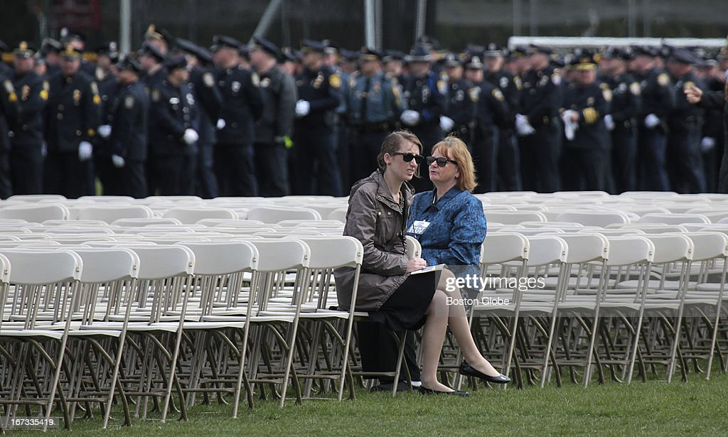 Police file into the memorial service for MIT police officer Sean Collier, at Briggs Field, on the MIT campus. Collier was killed during a shootout with the Boston Marathon bombing suspects.