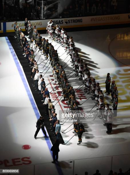 Police fire and medical personnel line up on the ice in front of the Vegas Golden Knights and the Arizona Coyotes before the Golden Knights'...
