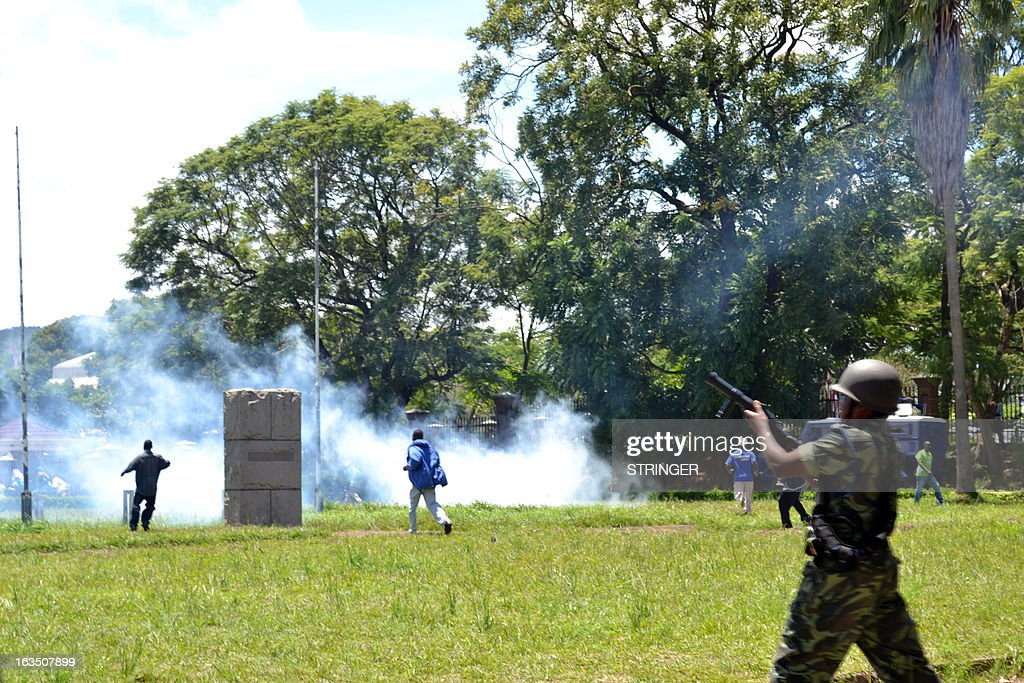 Police fire tear gas at supporters of Former Foreign affairs minister during a demonstration in Blantyre on March 11, 2013. Malawi police on March 11 arrested 11 ex-ministers and senior government officials, including the former president's brother, for an alleged coup plot, sparking protests met with police tear gas.