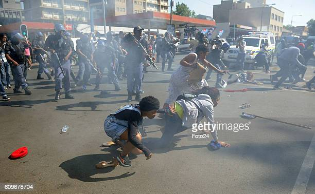 Police fire teargas and rubber bullets at Wits University students during the #FeesMustFall protest on September 21 2016 in Johannesburg South Africa...
