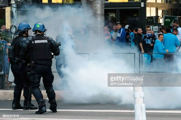 Police fire tears gas at Olympique de Marseille supporters on October 22 near the Velodrome Stadium in Marseille southeastern France a few hours...