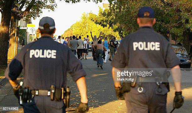 Police follow supporters up Ross street in Parramatta after the football match between the Bonnyrigg White Eagles and Sydney United at Parramatta...